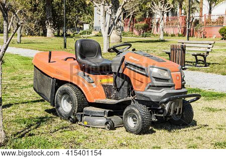Side, Turkey 03.18.2021 Heavy Duty Garden Tractor Husqvarna For Lawns With Large Wide Tires. Tractor