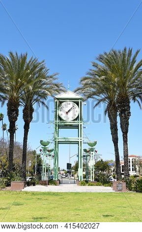 GARDEN GROVE, CALIFORNIA - 31 MAR 2021: Clock Tower on the Village Green, the oldest park in the city adjacent to the historic downtown district.