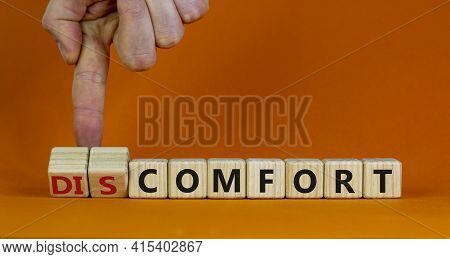 From Discomfort To Comfort Symbol. Psychologist Turns A Cube And Changes The Word 'discomfort' To 'c