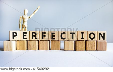 Perfection Symbol. Wooden Cubes With The Word 'perfection'. Wooden Model Of Human. Beautiful White B