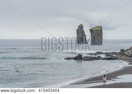 Mosteiros Beach, Volcanic Sand Beach In Sao Miguel, Azores With The Island Rocks