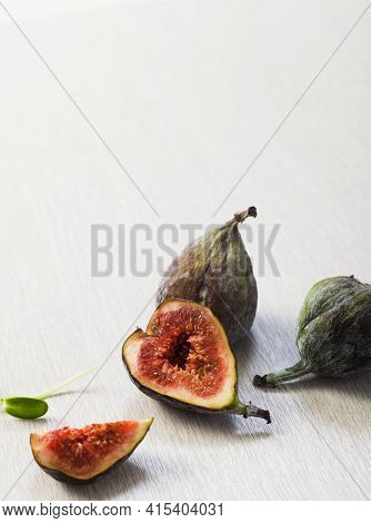 Fresh Ripe Figs On Table. Healthy Mediterranean Fig Fruit. Fresh Figs On Wood Background.