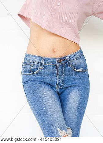 Shapely Girl, Slim Woman. Close Up Body Shape Woman With Pink Shirt And Jeans On White Background. I