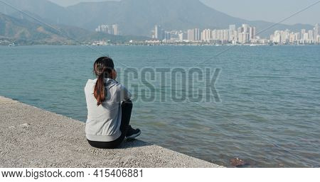 Woman sit on the jetty pier