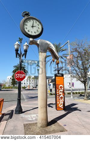 ANAHEIM, CALIFORNIA - 31 MAR 2021: The Hammer Clock by artist Daniel Martinez at the corner of Clementine and Promenade in the downtown Ctr City area.