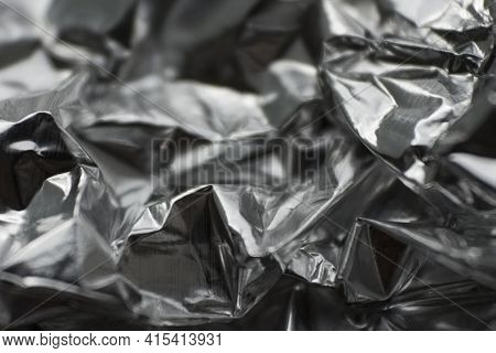 Crumpled Silver Foil Background. Foil Texture. Macro Photography