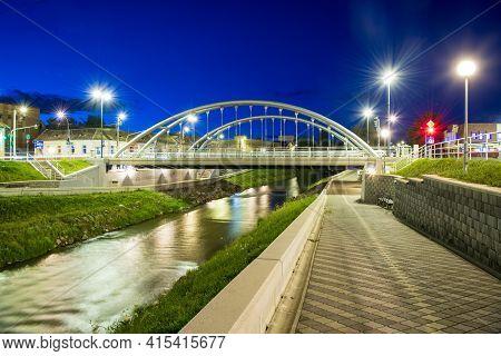 Arch Bridge Over Cibin River At Night With Amazing Blue Sky. Sibiu, Transylvania, Romania Europe