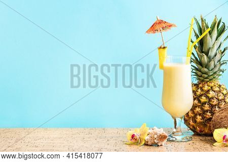 Pina Colada Cocktail Drink With Pineapple And Coconut, Blue Background, Copy Space. Summer Tropical