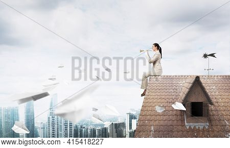 Beautiful Young Woman Playing Trumpet On Roof. Brave Girl In White Business Suit With Music Brass In