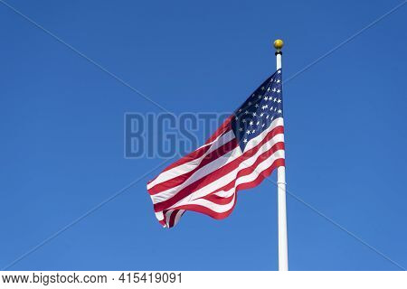 American Flag Blowing In The Wind With A Blue Sky, Usa American Flag.