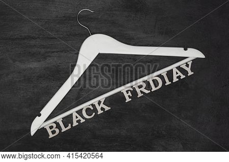 White Hanger And Black Friday Inscription, Black Background. Discounts. Special Offer