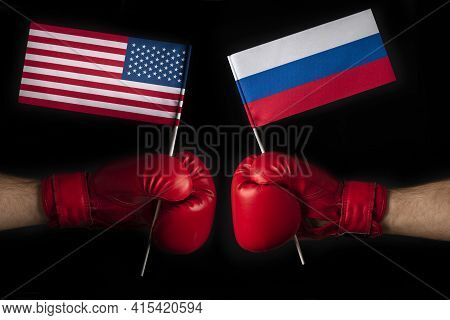 Two Boxer Hands With Usa And Russian Flags. Superpower Confrontation Concept. Opposition Between The