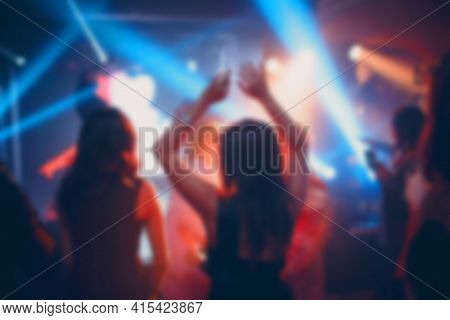 Silhouettes Of A Crowd On Show In Night Club Celebration. Blurred, Bokeh, Background, Restaurant.