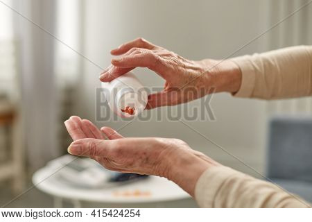 Senior Woman Sit On Couch Having Daily Vitamins Or Diet Supplements At Home, Mature Old Female Pensi