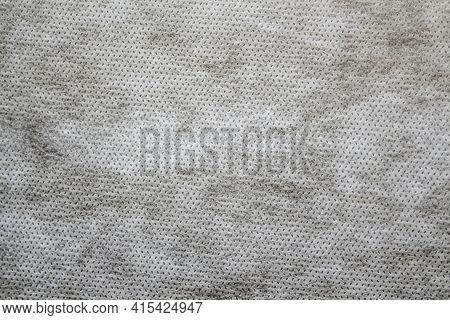 Defocus Grey Spunbond Non-woven Geotextile Close-up Macro. Close Up. Small Spots. Dirtied Texture. D
