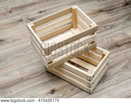 Pair Of Wooden Boxes On The Wooden Floor. Hight Angle View. Close-up