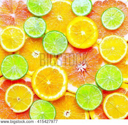 Summer Background Of Citrus Fruits. Sliced Citrus.