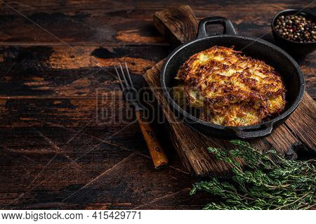 Fried Potato Pancakes Or Fritters With Herbs In A Pan. Dark Wooden Background. Top View. Copy Space