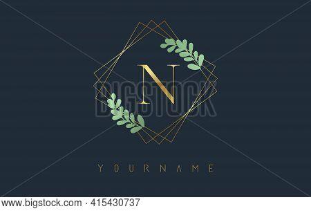Golden Letter N Logo With Golden Square Frames And Green Leaf Design. Creative Vector Illustration W