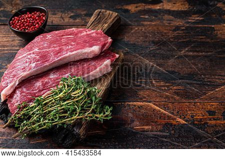 Raw Top Sirloin Cap Steak Or Picanha Steak On Wooden Board With Thyme. Dark Wooden Background. Top V
