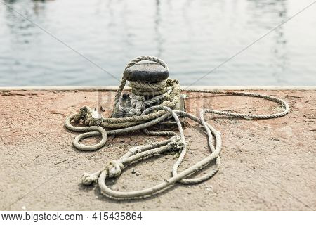 Pier, Mooring Bollard Of A Boat With Rope\nobject To Moor A Ship In The Port
