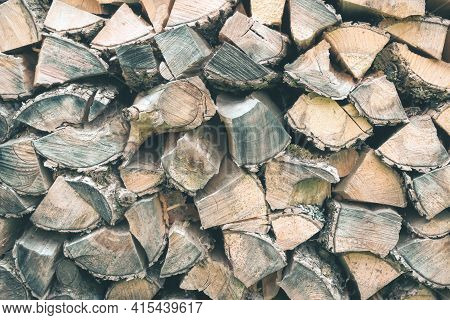 Old Wooden Pile Prepared For Winter. Fuel For Countryside Fireplace. Forest Timber Energy Concept, T