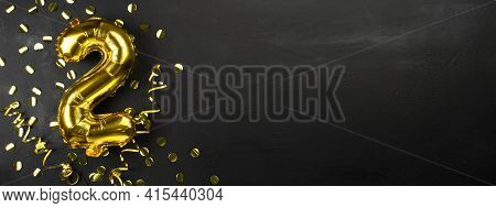 Gold Foil Balloon Number Two Or Two, Birthday Greeting Card With The Inscription 2. Black Concrete B
