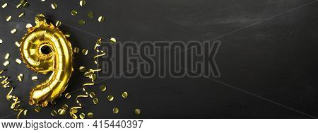 Gold Foil Balloon Number Nine Or Ninth. Birthday Greeting Card With The Inscription 9. Black Concret