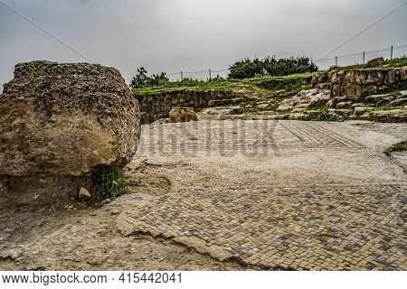 An Ancient Mosaic Floor In The Archeological Site Of Khirbat Umm Burj, Israel, On An Overcast Day.