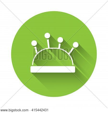 White Needle Bed And Needles Icon Isolated With Long Shadow. Handmade And Sewing Theme. Green Circle