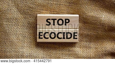 Stop Ecocide Symbol. Wooden Blocks With Words Stop Ecocide. Beautiful Canvas Background, Copy Space.
