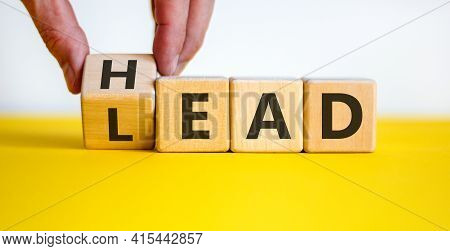Head Lead Symbol. Businessman Turns The Cube And Changes The Word 'lead' To 'head'. Beautiful Yellow