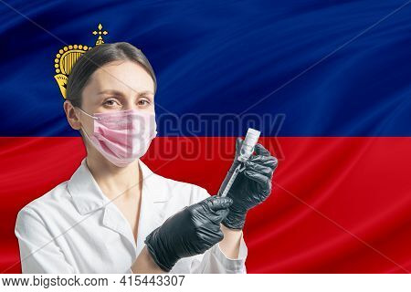 Girl Doctor Prepares Vaccination Against The Background Of The Liechtenstein Flag. Vaccination Conce