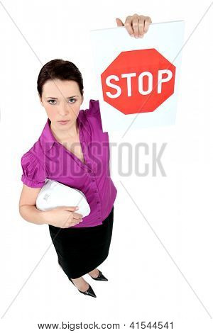 Architect holding stop sign