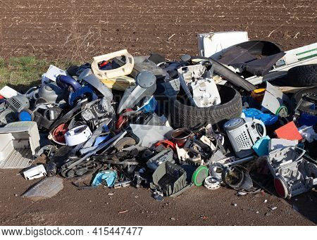 Poznan, Poland - April 02, 2021: Illegal Landfill In Nature. Construction And Household Garbage In A