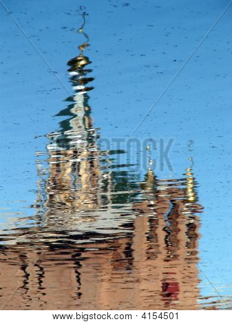 Church Cupola Reflected In Wavy Water 1