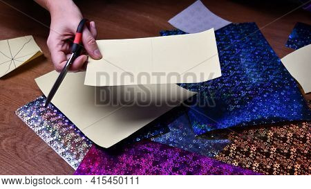 Woman Hand Hold Piece Of Craft Paper And Scissors. Diy Craft Project Making With Glittering Craft Pa