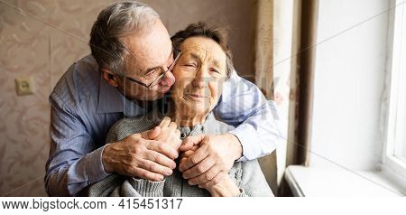Grown Man And Old Mother, Happy Mature Mom And Grown-up Adult Son Rest At Home Enjoying Family Weeke