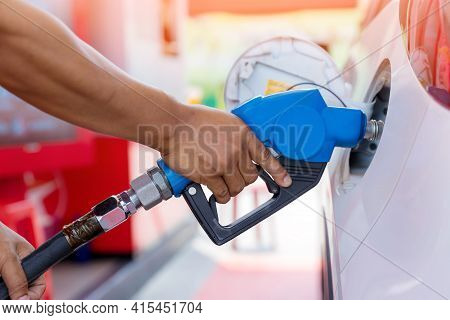 Hand Man Refill And Filling Oil Gas Fuel At Station. Gas Station - Refueling. To Fill The Machine Wi