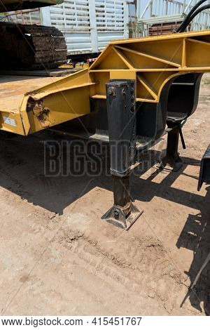 Hydraulics Crane Support Is On Ground. Hydraulic Outriggers Of The Crane Installed On The Truck. Tel