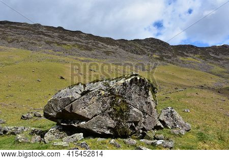 Large Bedrock Boulder On The Side Of A Mountain.