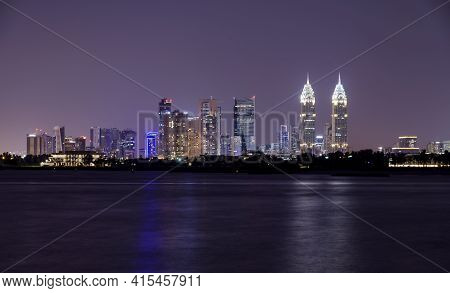 11 dec 2020, Palm jumeirah, Dubai.A panoramic view of the illuminated Dubai skyline with the majestic skyscrapper, business centers and apartments captured at the Palm jumeirah east, Dubai , UAE.