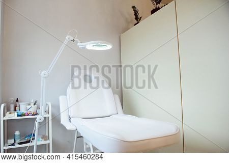 Interior Of A Cosmetology Office.modern Equipment Of Cosmetology.white Chair For Cosmetology Procedu