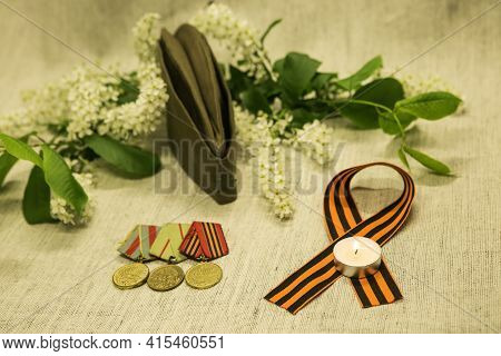 Victory Day. We Remember The Exploits Of Our Grandfathers. St. George Ribbon, Medals, Military Lette