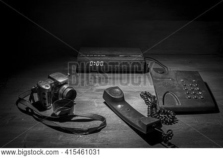 Black And White Retro,vintage Photograph Of A Radio Next To An Old Camera And Phone.old Camera.old R