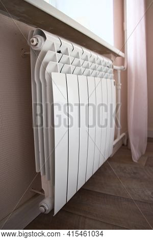 Modern Home Heating Radiator Under The Window. Bimetal, Aluminium Radiator. Heating System.
