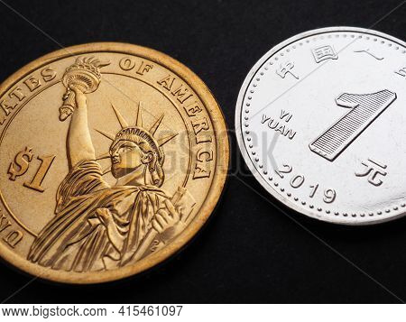 Translation: People's Bank Of China, One Yuan. The American 1 Dollar Coin And The Chinese 1 Yuan Coi