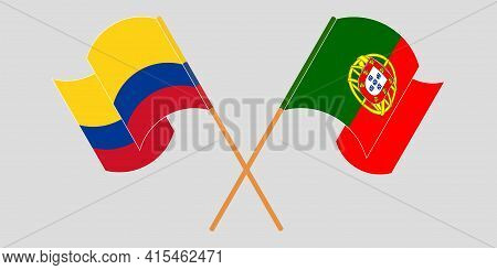 Crossed And Waving Flags Of Colombia And Portugal