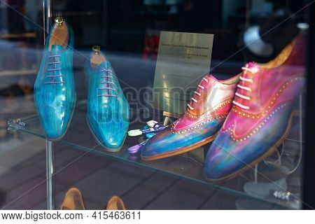 Beaune, France - August 03, 2019: Fashionable Luxury Mens Shoes On A Shop Window