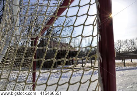 Lens Flare In The Park With Ice Hockey Rink